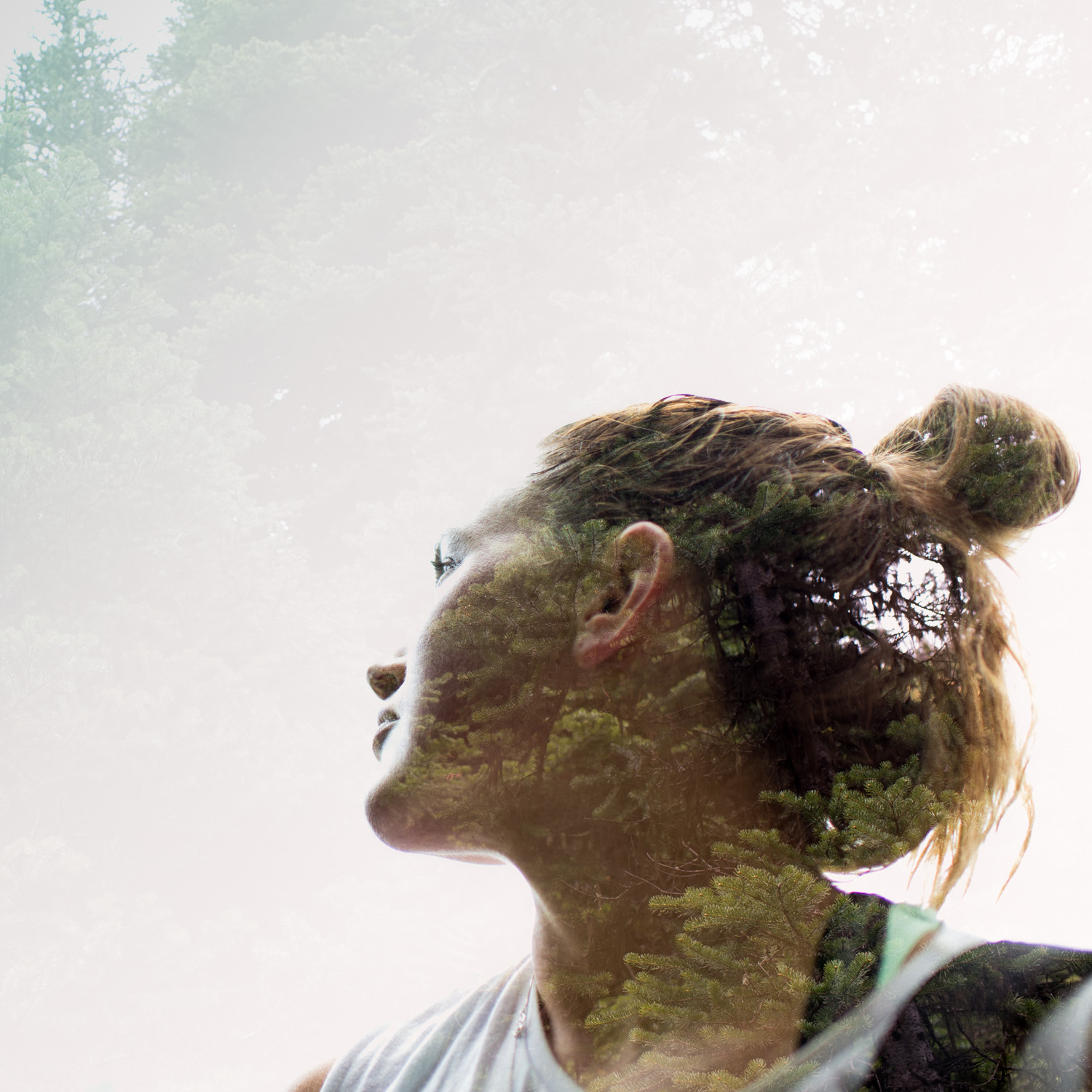 Oneness with nature sympbolised by a multiple exposure portrait